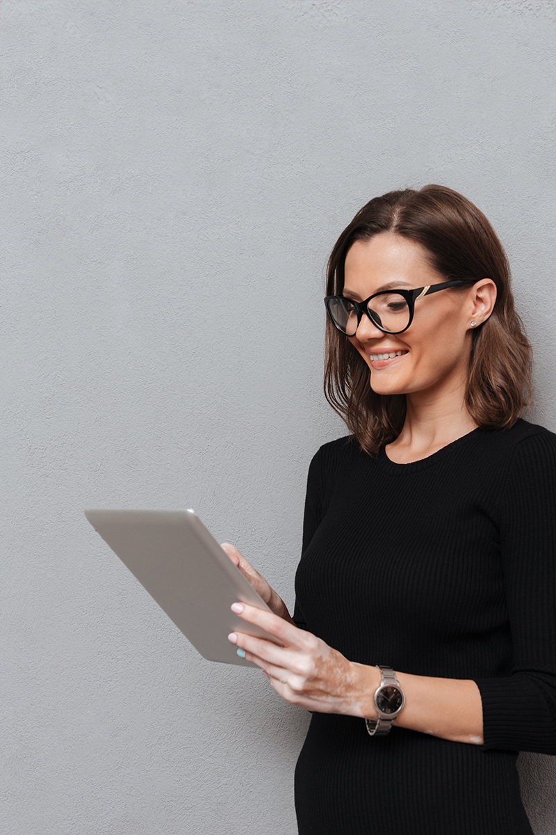 Woman checking Newsletter